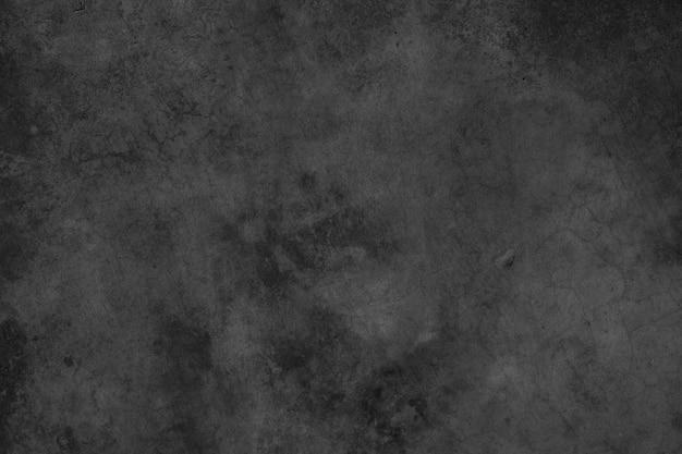 汚れたセメントの暗いまたはコンクリートの壁のテクスチャの背景。