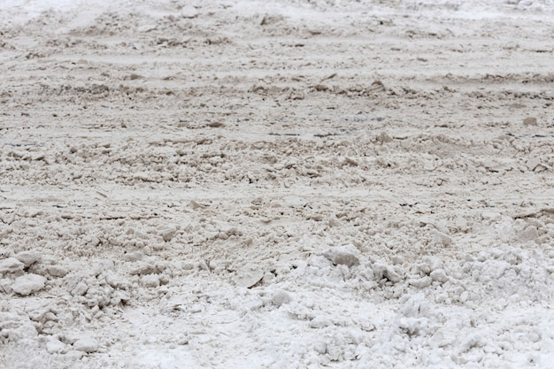 Dirty city in winter. piles of snow on the roadway. high quality photo