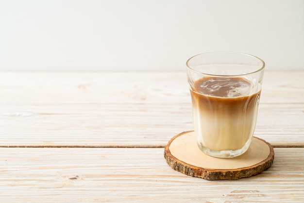 Dirty coffee glass, cold milk topped with hot espresso coffee shot