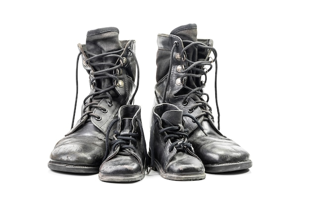 Dirty combat boots for adult and kid isolated on white with clipping path