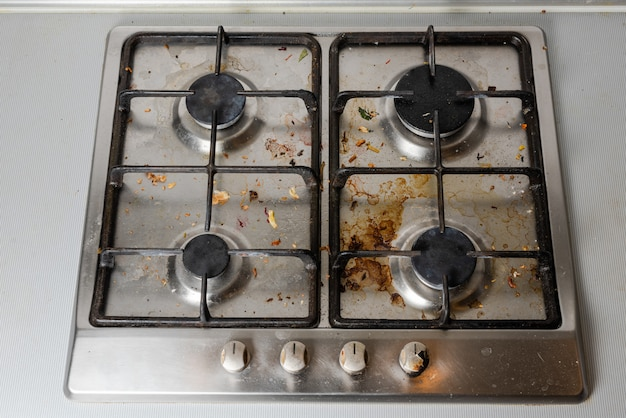 Dirty gas stove in the kitchen