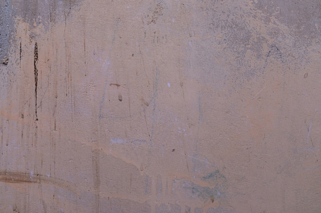 A dirty grey filled beton wall