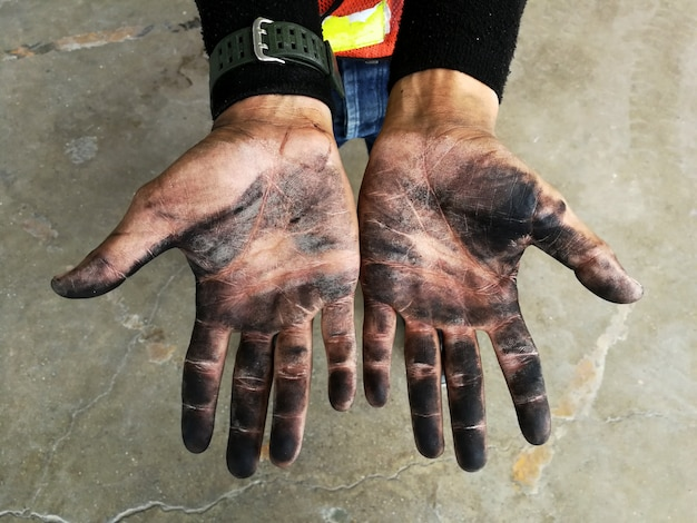 Dirty hand of worker