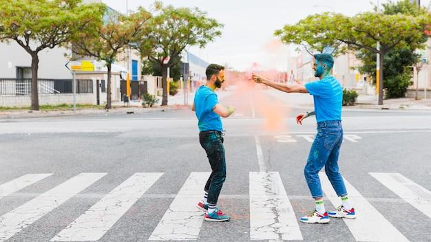 Dirty joyful gay couple having fun on road