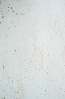 Dirty light grey cement grungy background texture for backdrop in high resolution close up view