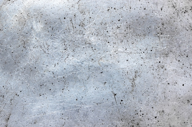 Dirty metal background, old iron sheet with damaged texture