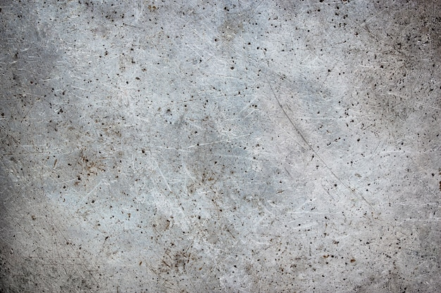 Dirty mettalic background with scuffs, iron texture with brushes from brush