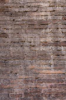 더러운 오래 된 벽돌 벽 배경