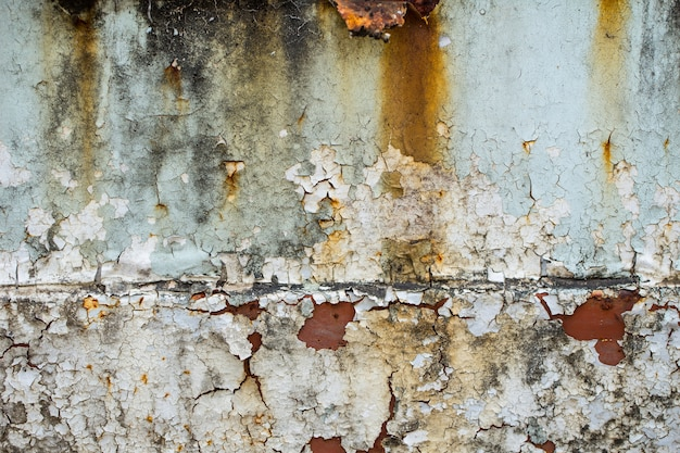 Dirty old rusty grungy peeling paint wall.