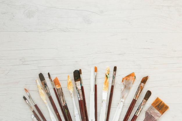 Dirty paint brushes and knives for art
