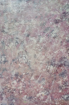 Dirty pink  venetian plaster, cement,  smooth surface, texture.