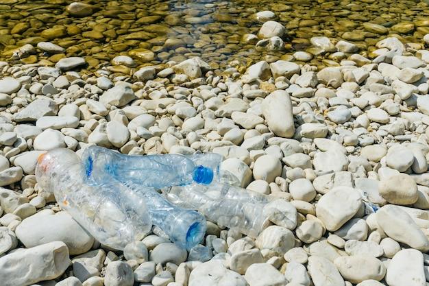 Dirty plastic bottles in water