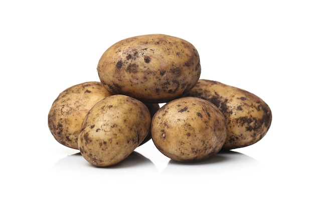 Dirty potatoes on a white surface