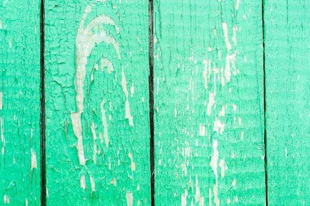 ペンキで汚れた汚れを一緒に槌で打ったフェンスヴィンテージ古い木の背景表面のテクスチャ