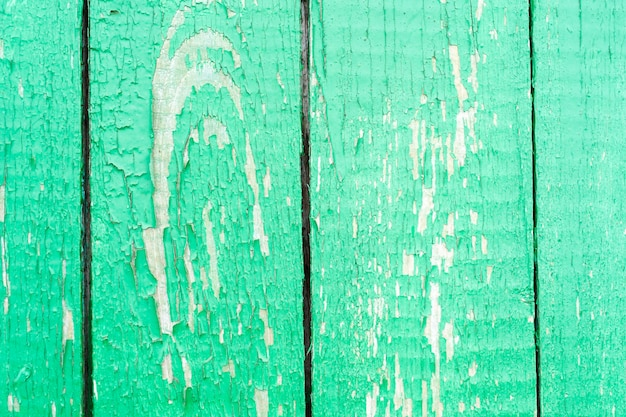 Dirty stained by a paint the hammered together fence vintage old wood background surface texture