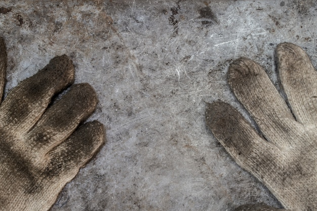 Dirty tools handyman glove workshop concept background top view