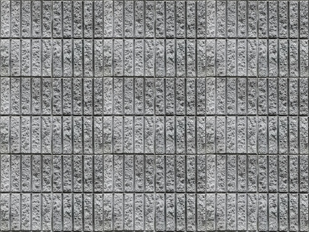 Dirty vertical cement brick block stack wall texture surface background.