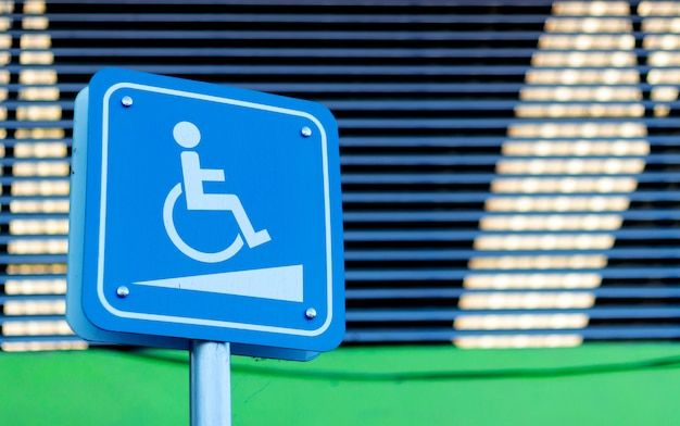 Disability car park sign with soft-focus and over light in the background