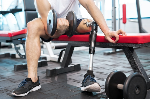 Disability sportsman training with weights