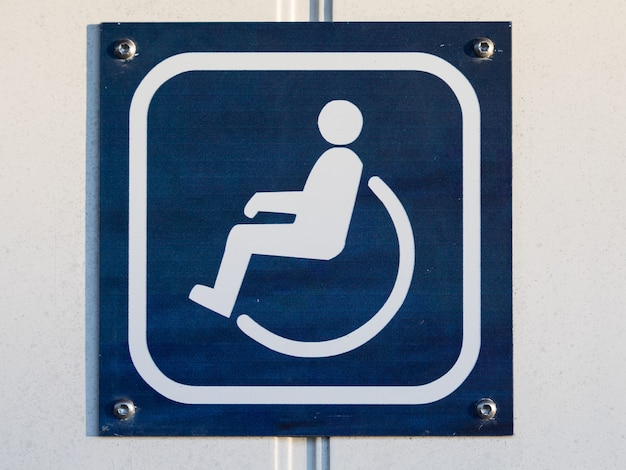 Disable toilet or wc sign on the door in blue and white