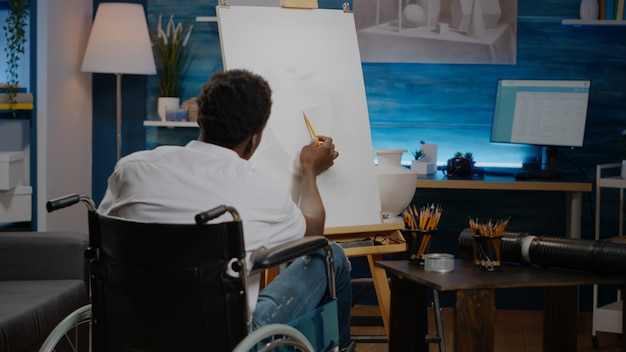Disabled african american artist working on drawing