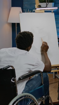 Disabled african american man working on drawing of vase