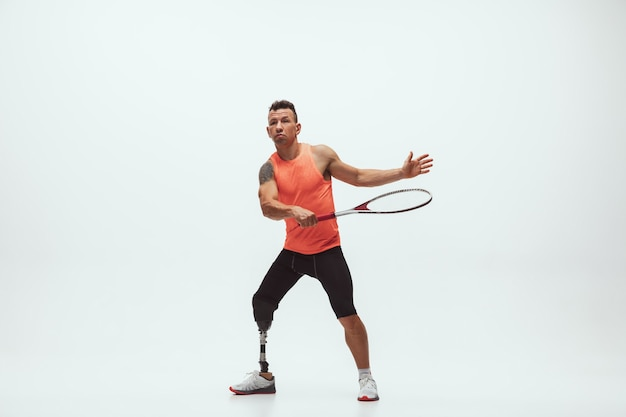 Disabled athlete on white background, tennis player