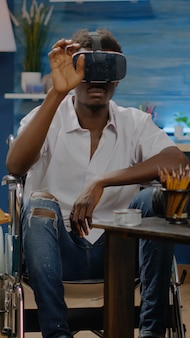 Disabled black artist using vr glasses for virtual inspiration