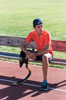 Disabled man athlete taking a break. paralympic sport concept.