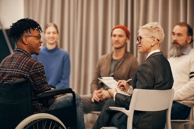 Disabled man at therapy class