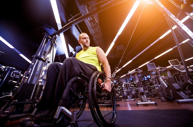Disabled man training in the gym
