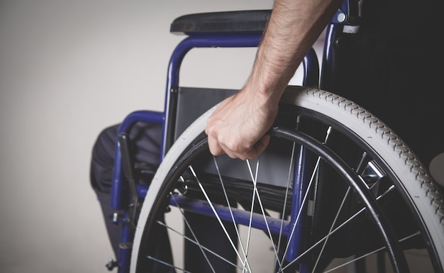 Disabled man in wheelchair in home.