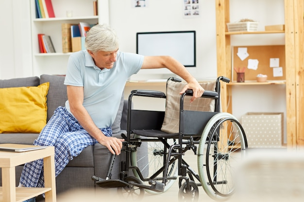 Disabled man with wheelchair
