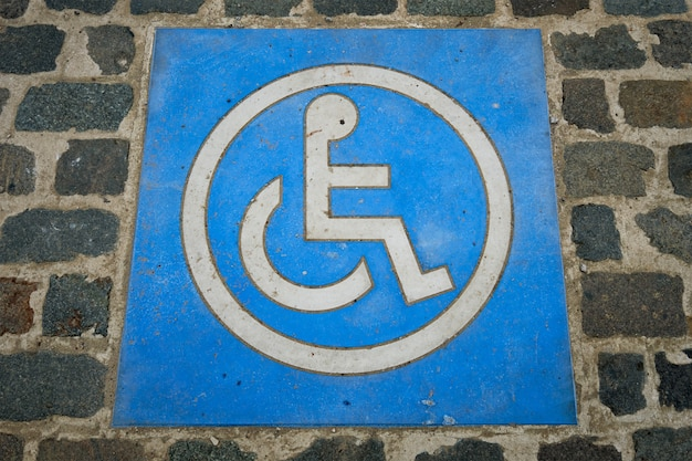 Disabled parking sign on ground