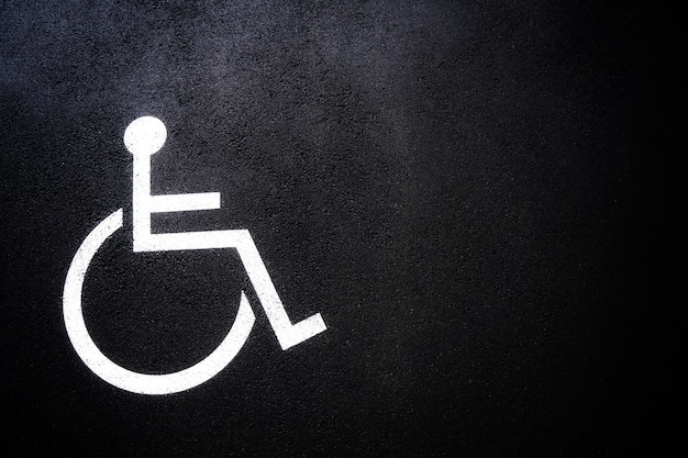 Disabled people icon or handicap symbol on parking space.