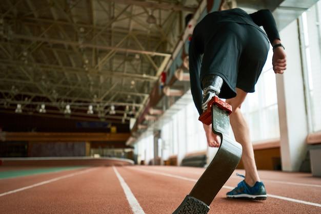 Disabled runner on start back view