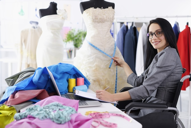 Disabled woman designer provides services for sewing wedding dresses. professions for people