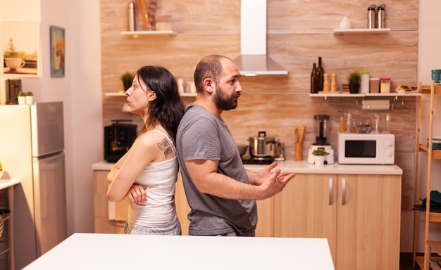 Disappointed husband suspecting wife of infidelity while having a relationship disagreement. frustrated offended irritated accusing woman of infidelity arguing her.