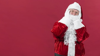 Disappointed Santa Claus in hat with hands on head