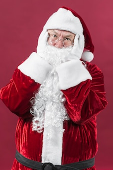 Disappointed santa claus with hands on head