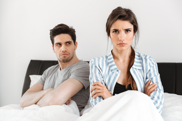 Disappointed young couple having a conflict