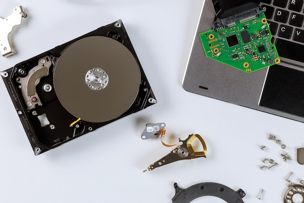 Disassembled a broken hard disk drive to repair center