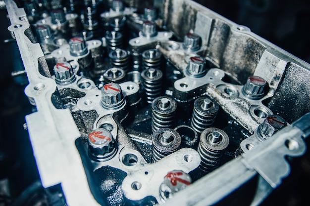 Disassembled car engine repair valve adjustment