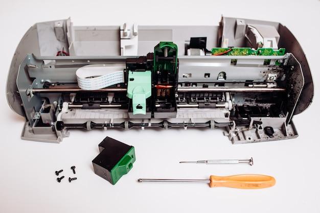 Disassembled ink jet printer on white