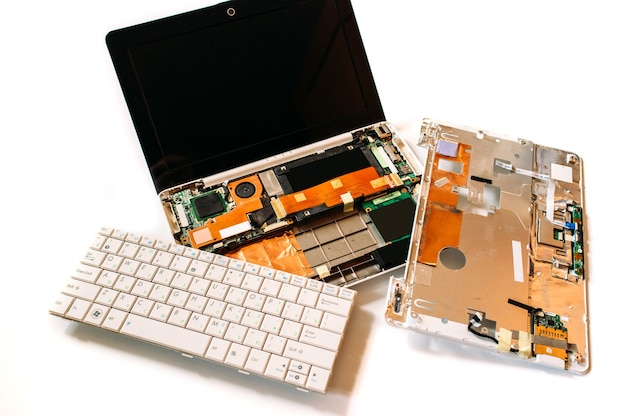 Disassembled laptop on white surface