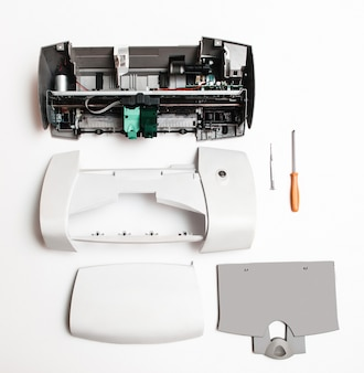 Disassembled printer on a white surface