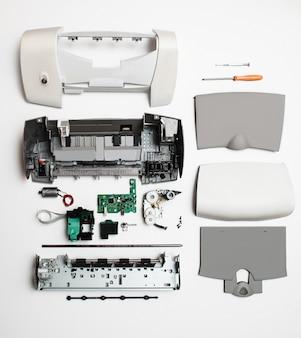 Disassembled printer on white