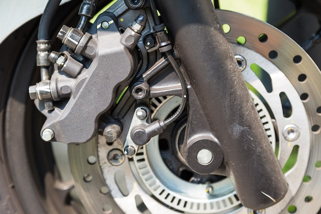 Disc brake of eco motorcycle, scooter motorcycle background