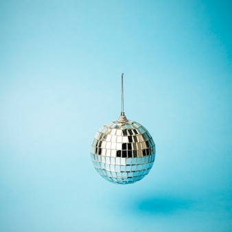 Disco ball on a colored blue background