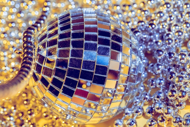Disco ball concept. isolated on yellow background